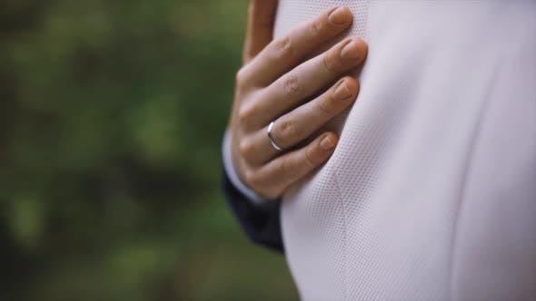 Thumbnail for Groom Hugs Bride 's Waist.