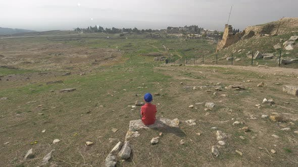 Thumbnail for A Steadicam Shot of a Boy Looking at the Ruins of Ancient Hierapolis