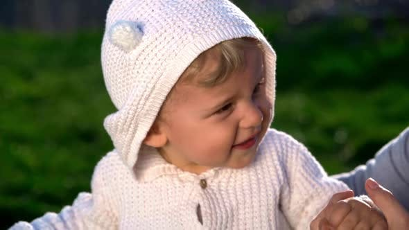 Thumbnail for Cute Portrait of Little Baby Boy Playing with Mother in Park or Green Garden. Smiling Happy Lovely