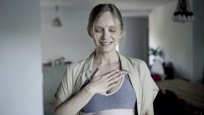 Front View of Calm Beautiful Woman Practicing Breath Exercises