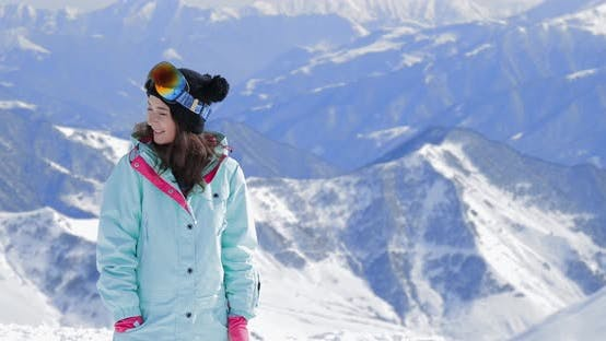 Thumbnail for Happy Girl Snowboarder with Snowboard Smiling on Ski Slope Backdrop