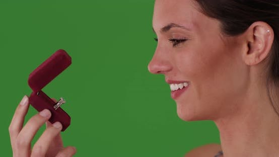Thumbnail for Caucasian woman admiring diamond engagement ring in jewelry box on greenscreen