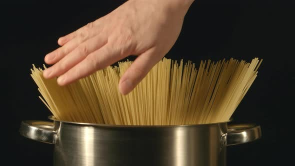 Thumbnail for A Cook Touches A Bunch Of A Spaghetti In A Steel Pot