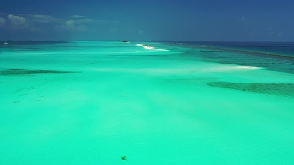 Cover Image for Natural drone island view of a sandy white paradise beach and aqua blue ocean background in hi res 4