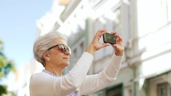 Thumbnail for Senior Woman Photographing By Smartphone in City 48