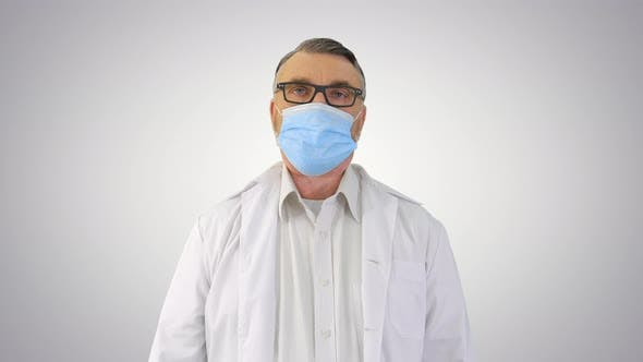 Thumbnail for Doctor in Medical Mask Against Coronavirus Covid-19 Breathing Heavily on Gradient Background