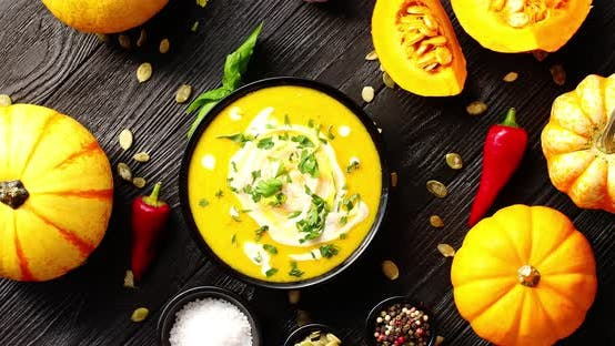 Thumbnail for Yellow Fresh Pumpkin Soup Surrounded By Spices and Seeds