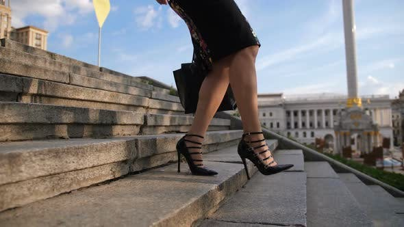 Thumbnail for Businesswoman's Legs in Heels Stepping Down Stairs