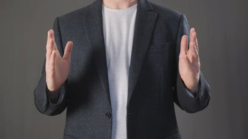Businessman Holding Empty Space with Both Hands