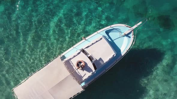 Aerial View of White Boat on Turquoise Sea Water