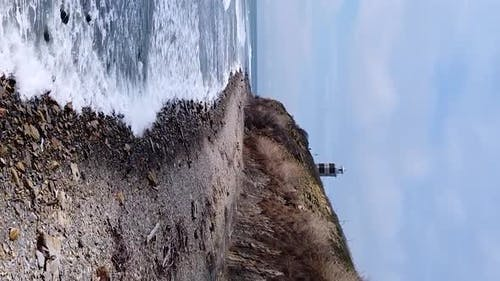 Vertical orientation video: Lighthouse on the sea coast
