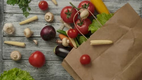 Vegetables Falling on Paper Bag with Groceries