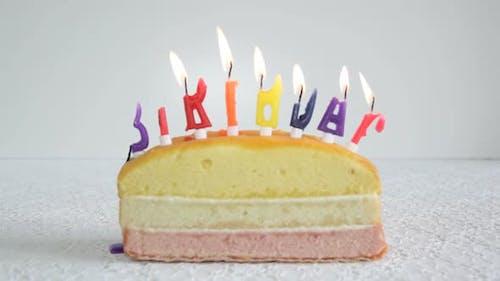 Time laps of birthday candles burning birthday cake