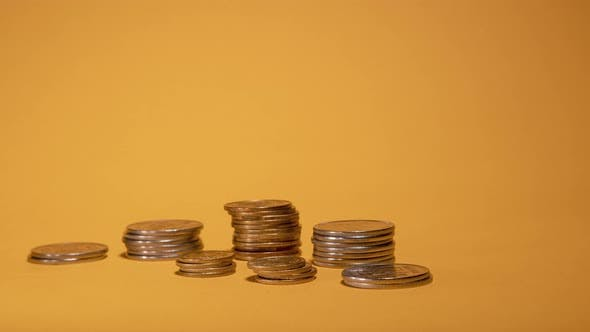 Thumbnail for Rows of Money Coins on Gold Background