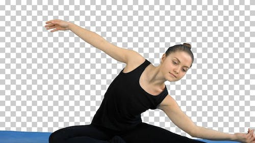 Fitness woman stretching her body doing pilates, Alpha Channel