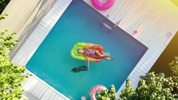 A Young Woman Relaxes in the Pool