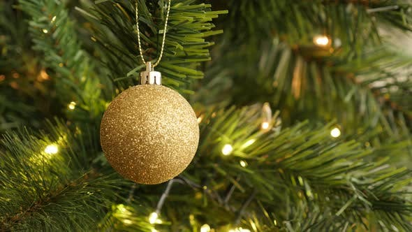 Thumbnail for Golden color Christmas ornament close-up 4K 2160p 30fps UltraHD footage - Sparkling  gold bauble on