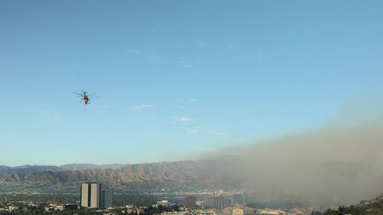 Thumbnail for Close Drone Footage of Huge Wildfire in Hollywood Hills. Helicopter Extinguishing