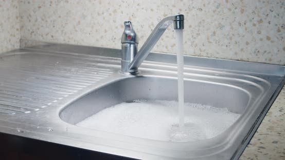 Overflowing Kitchen Sink with Water and Foam Blockage Sin