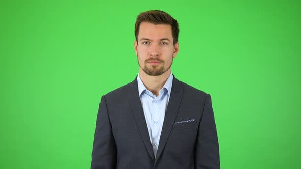 Thumbnail for A Young Handsome Businessman Throws Out His Hands and Looks Around Helplessly - Green Screen Studio
