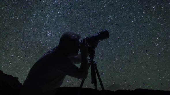 Thumbnail for Male Photographer Taking Pictures And Watching Night Starry Sky In Mountains