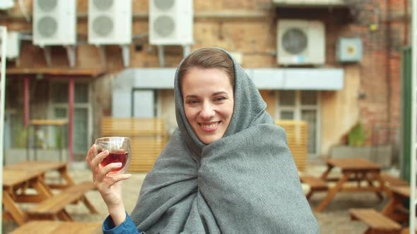 Thumbnail for Woman Stand on the Street, Drink Tea and Look at the Camera Laughing