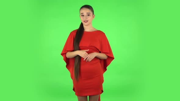 Thumbnail for Pretty Young Woman Is Talking About Something Then Making a Hush Gesture, Secret. Green Screen