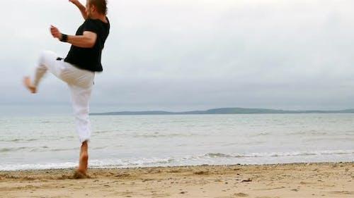 Fit Man Practicing Martial Arts