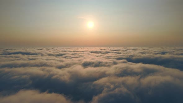 Fabulous Sunrise Over the Clouds. Flight Over the Morning Fog Above the Sky and Sunbeams That