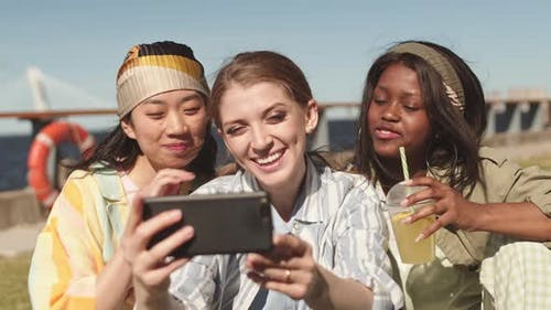 Multiethnic Women Video Chatting Outdoors