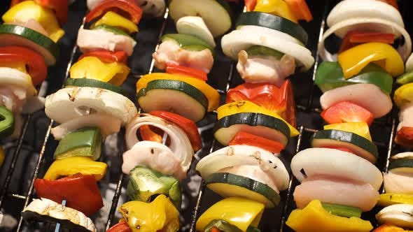 Thumbnail for Multiple Colorful and Tasty Grilled Shashliks on Outdoor Summer Barbecue