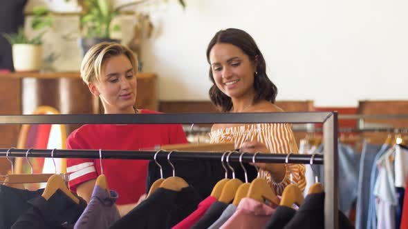 Women Choosing Clothes at Vintage Clothing Store