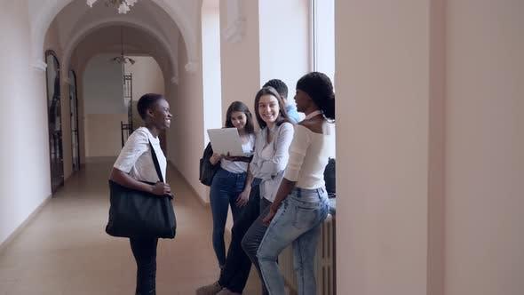Students Talking in Corridor During Break in College