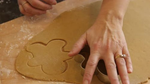 Cutting out gingerbread men cookies