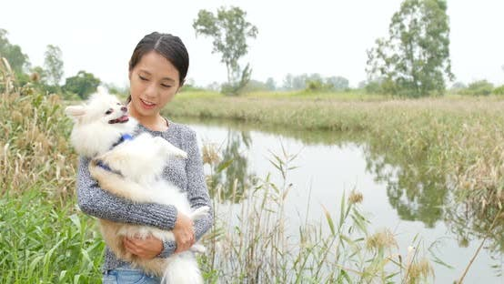 Thumbnail for Woman be with her dog in countryside