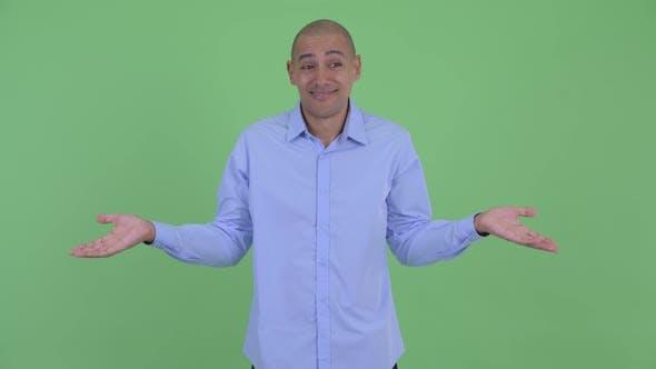 Thumbnail for Confused Bald Multi Ethnic Businessman Shrugging Shoulders