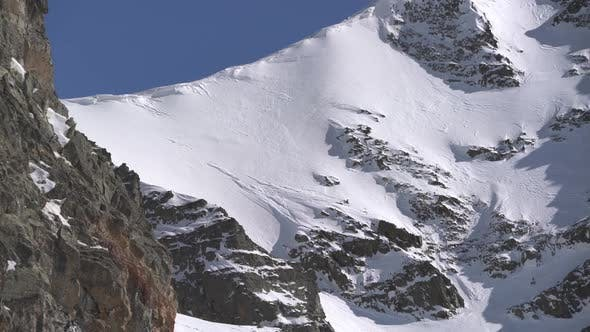Thumbnail for Snow Eaves and Rocky Wall at Mountain Summit