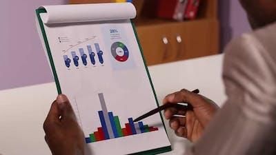 Businessman Studying Graphics