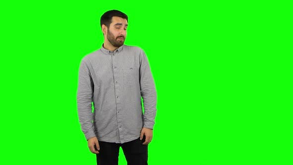 Thumbnail for Brunette Guy Is Waiting and Yawning with Boredom. Green Screen
