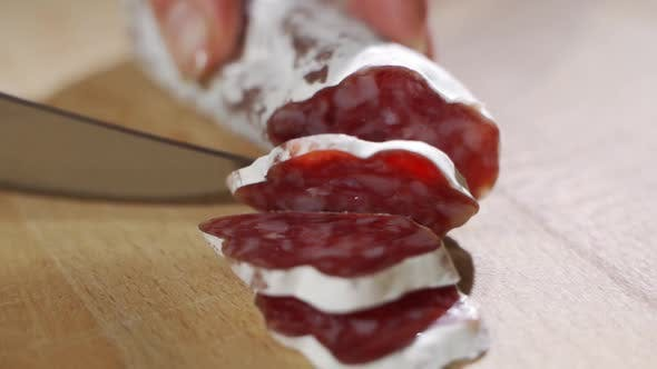 Thumbnail for Hand Expert Cuts Parma Seasoned Salami, Thinly Sliced with a Knife and Emanates the Taste and the