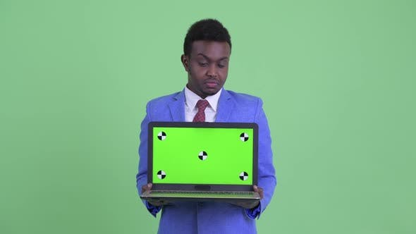 Thumbnail for Stressed Young African Businessman Showing Laptop