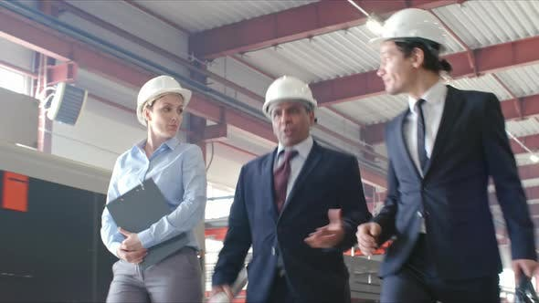 Cover Image for Group of Executive Engineers Walking in Factory