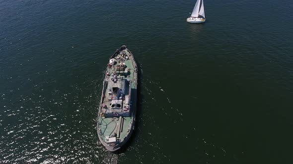 Thumbnail for Aerial Shot of a Cargo Ship Floating in the Dnipro on a Sunny Day in Summer