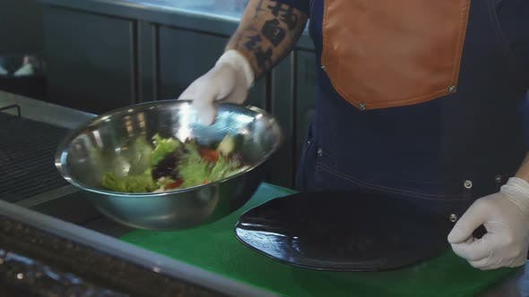 Thumbnail for Cropped Shot of a Chef Putting Salad on a Plate