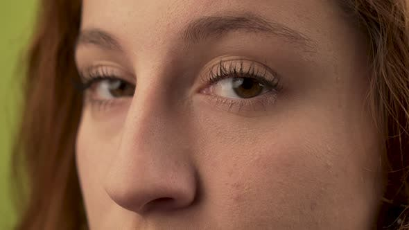 Thumbnail for Closeup portrait of woman eyes looking to camera