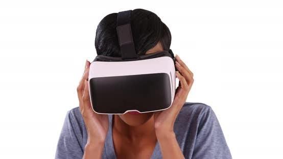 Thumbnail for Black female in her 20s using smartphone vr headset on white background, smiling