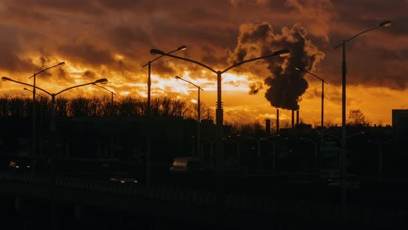 Cover Image for Industrial Zone From City Pipe Thick Smoke is Poured From Factory Sunset, Pollute Atmosphere