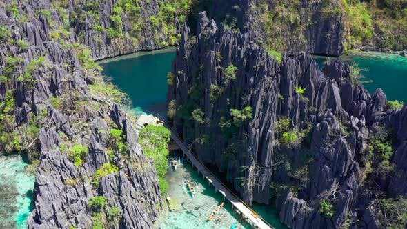 Thumbnail for Aerial Views on Beautiful Emerald Twin Lagoons and Boats in Coron Island, Palawan, Philippines