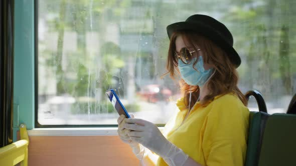 Thumbnail for Precautions, Female Passenger Wearing a Medical Mask and Gloves To Protect Against Virus and