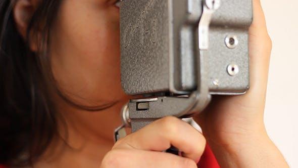 Thumbnail for Girl Shooting on Vintage Reel Camera